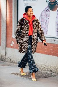 Leopard printed coat with tarten trousers