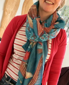 large printed scarf over stripes