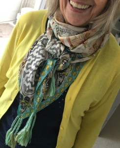 Green print scarf over yellow