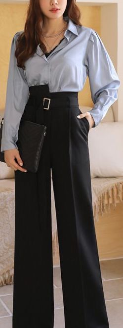 Model showing trousers as a separates outfit, with a beautiful blouse instead of a jacket.