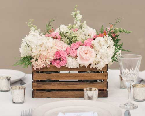 Pick up enough of those babies and, with a little scrap wood, some stain, and a staple gun, you can DIY your own farm crate inspired centerpieces!