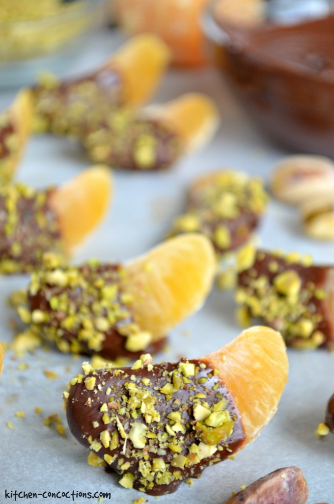{Kitchen Concoctions} Dark Chocolate Covered Clementines with Toasted Pistachios - Just because you are eating healthy doesn't mean you have to miss out on a sweet treat! These Dark Chocolate Covered Clementines with Toasted Pistachios are a rich and diet friendly indulgence that will surely satisfy your sweet tooth!