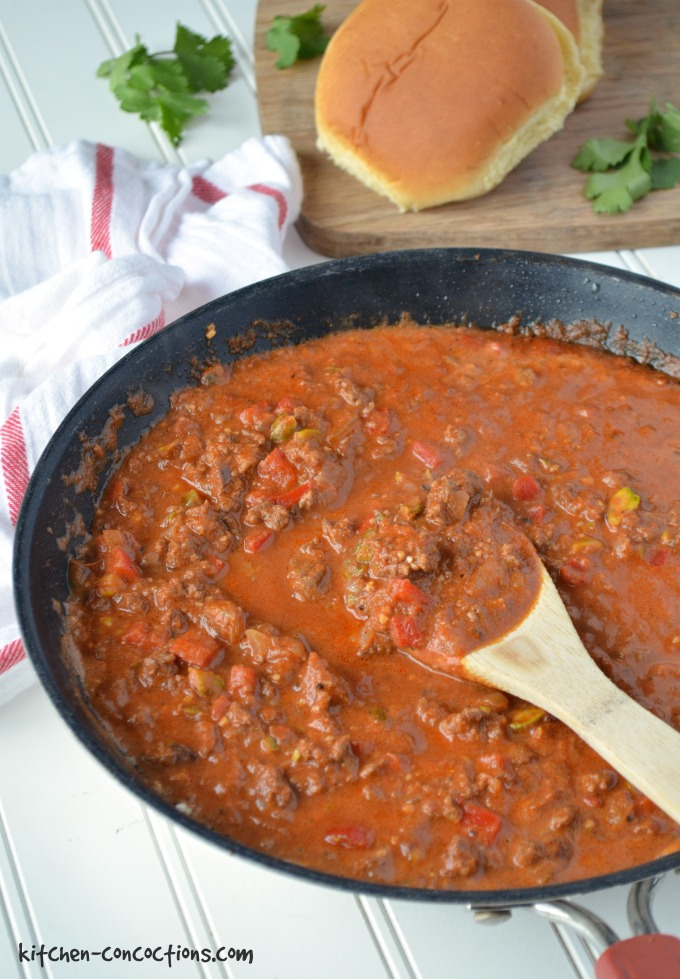 Bombay Sloppy Joes (Kheema Pav) cooked in s skillet with a wooden spoon