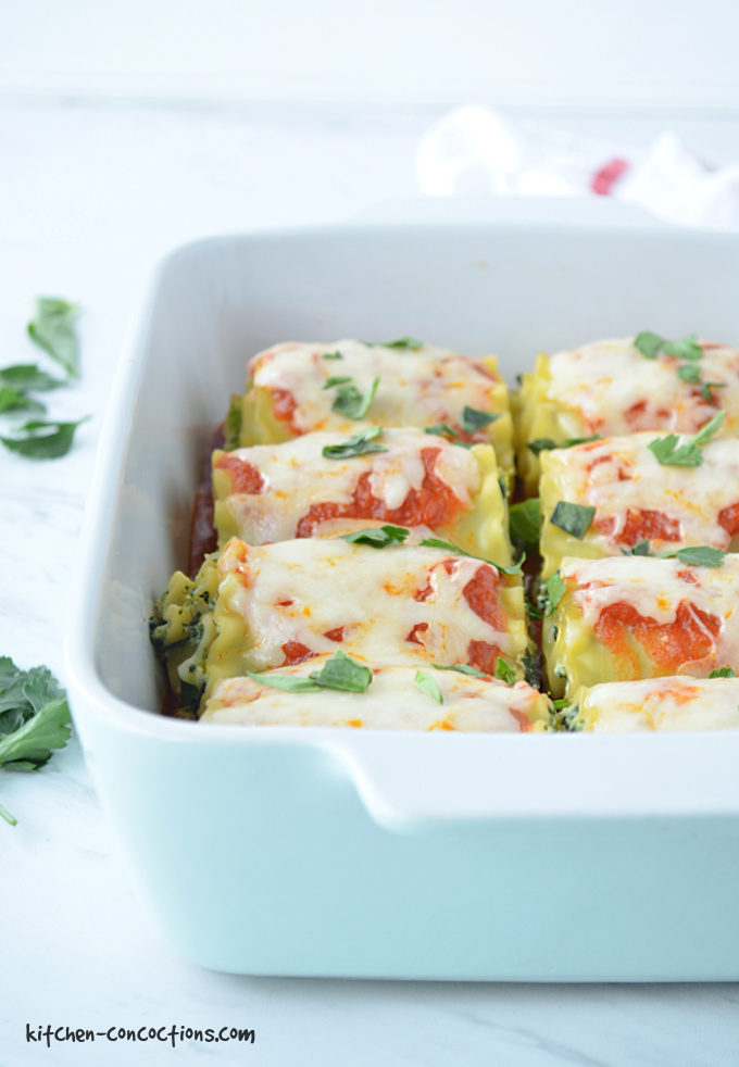 baked Vegetarian Lasagna Roll Ups in a white and blue baking dish