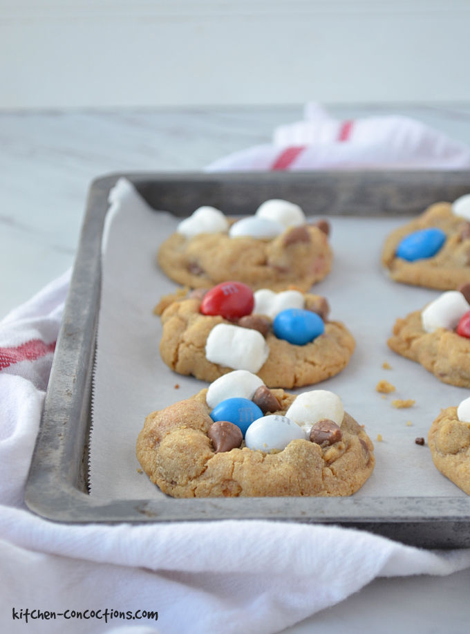 Baked Peanut Butter S'mores Cookies on a cookie sheet lined with parchment paper