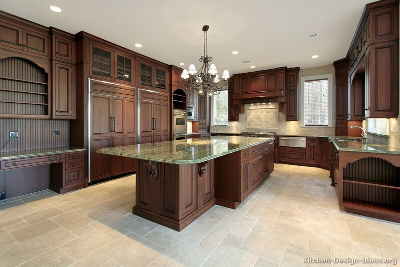 luxury kitchen with dark cherry cabinets green granite travertine