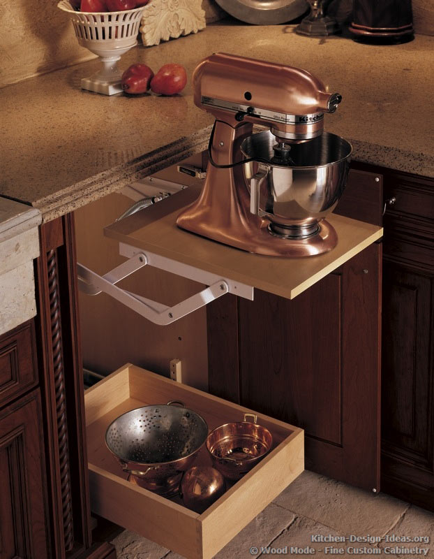 Save counter space by storing your stand mixer in a base cabinet. This one is built onto a mechanized cabinet lift for frequent access.