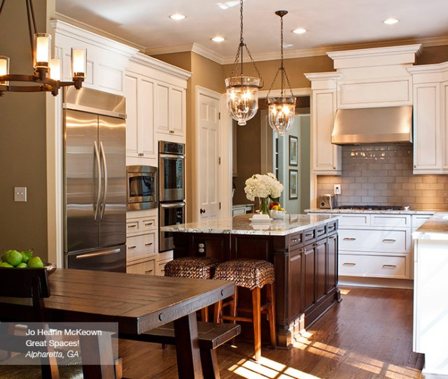 Craft Cabinetry Off White Glazed Cabinets With A Dark Kitchen Island