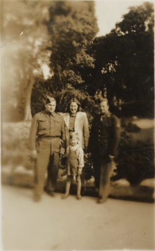 Irmgard and Walter Brill (in British army uniform), with young Winston Jonas, plus colleague; Second World war