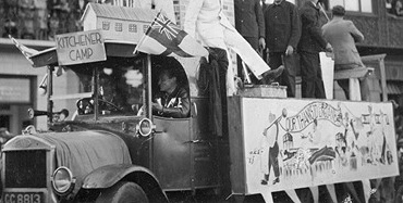 Float from Kitchener camp with dressed up men on top and banner saying 'Our Thanks to England' in a parade in 1939 Image WL6121