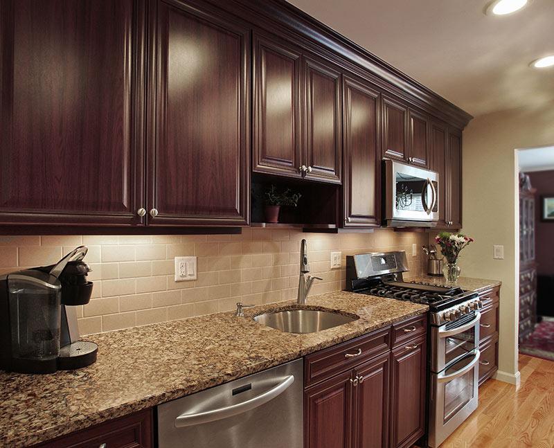 Backsplash Options: Glass, Ceramic Tile or Grout Free Corian on Backsplash For Dark Countertops  id=86386