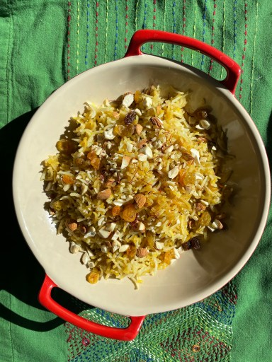 A dish of Zarda on a green table cloth