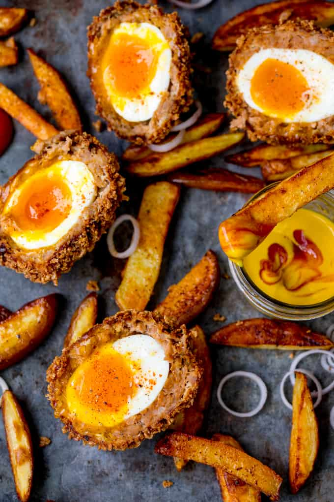 TheseChorizo Scotch Eggs are epic! Crispy and smoky on the outside with a perfect runny-egg filling!