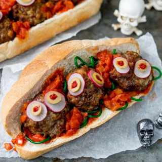 Juicy meatballs in a yummy tomato-based sauce - this Halloween Eyeball Sub is spooky and it makes a delicious dinner! The kids will love it!