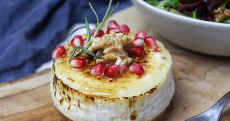 Baked goat cheese with honey, pomegranate and rosemary