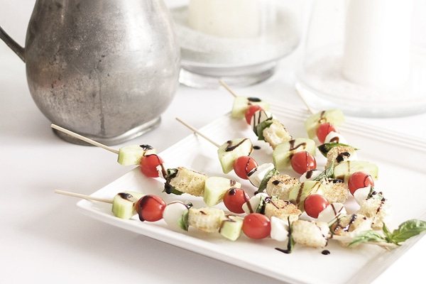 Panzanella salad skewers with tomatoes, cucumbers, bocconcini cheese, fresh basil, homemade croutons, and balsamic glaze. A great looking, easy appetizer. | Kitchen Trials