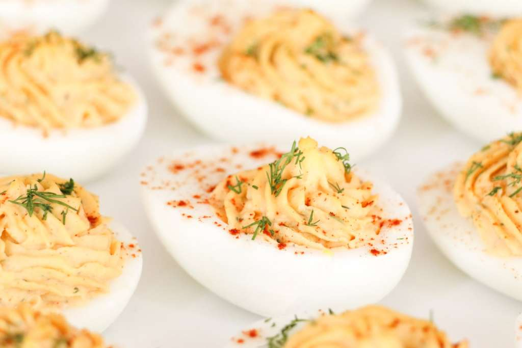Deviled Eggs with a classic creamy filling. You'll be shocked at how easy and delicious these are!