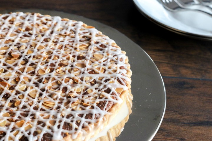 The Bakewell tart is a simple British almond tart with a hidden raspberry filling and delicate drizzled icing. Perfect after dinner with a cup of tea or coffee!