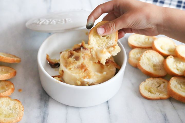 Creamy brie with roasted garlic makes the perfect holiday appetizer. Recipe includes 4 different variations, including how to stack the perfect brie platter.