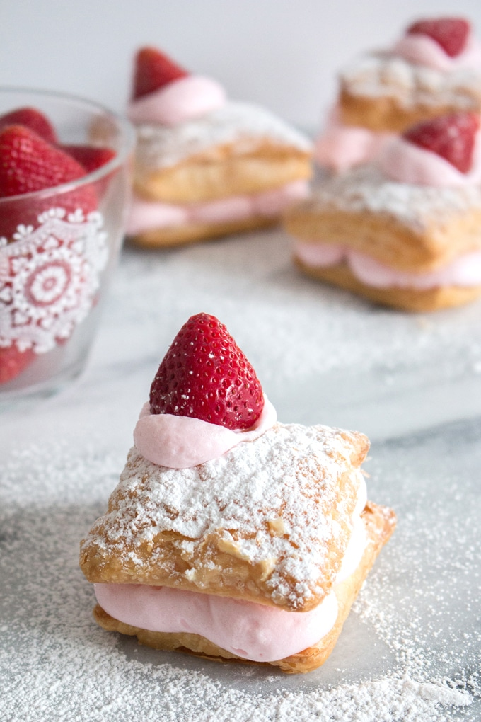 A super easy way to make cream puffs. All you need is store bought puff pastry, mousse mix, and something to make it look fancy (like fresh berries) This is a great summer dessert you can throw together in no time!