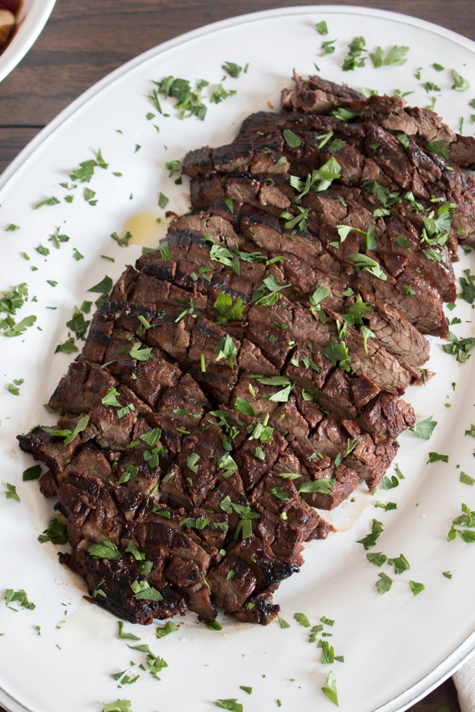 A flavour packed flank steak thanks to a surprisingly simple marinade that you quickly grill for one of the easiest, and tastiest meals of the summer! This is actually the steak I caught my husband with!