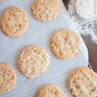 Thick and chewy vanilla cookies loaded with tiny bites of salted toffee and roasted almonds. Just like the ones Panera Bread used to sell , and Mrs. Fields makes (without the roasted nuts).
