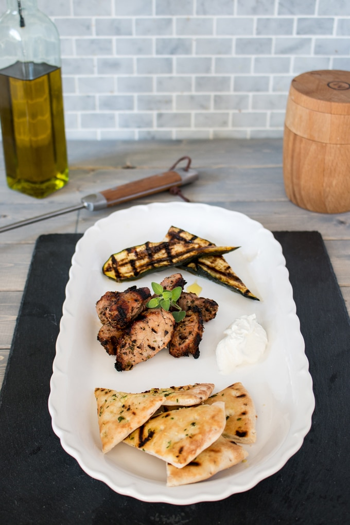 Tender and flavourful bites of pork with a garlicky marinade, these pork souvlaki are just as good as your favorite take out, and can still be a quick weeknight meal. Pair it with some fresh herb and garlic grilled pitas, and you'll never order in again!