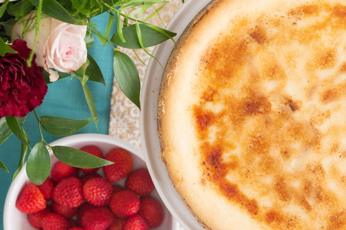 """A fusion of traditional and Italian style cheesecake leaves this one bursting with bright flavour in every extra smooth and creamy bite. The """"icing"""" on this cake? A crisp, caramelized, brûlée topping that will have everyone begging you for seconds."""