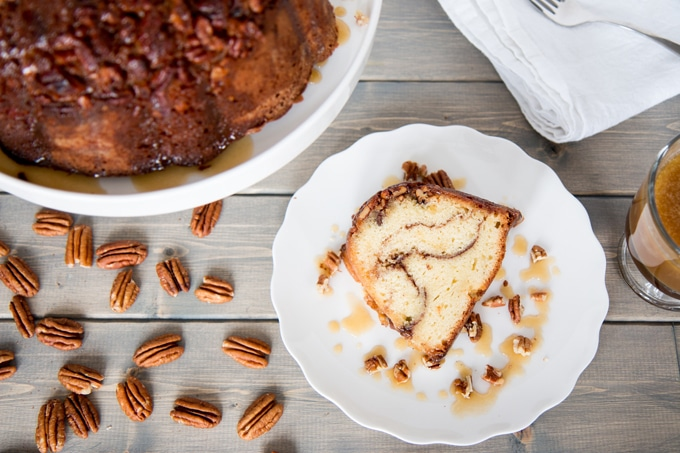 Everything you love about a sticky bun (cinnamon swirls, caramel, and praline pecans) in a super moist coffee style bundt cake!