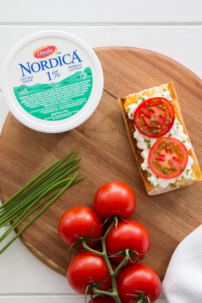 An open face cheese and tomato sandwich is the perfect quick meal for a busy day.