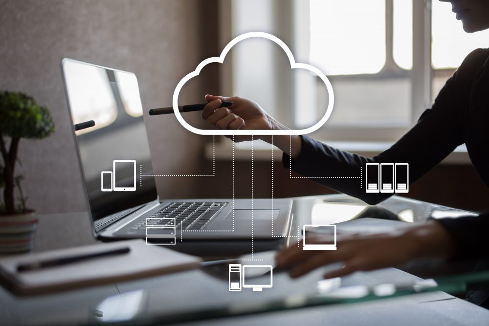 person pointing at computer with cloud image and IT services