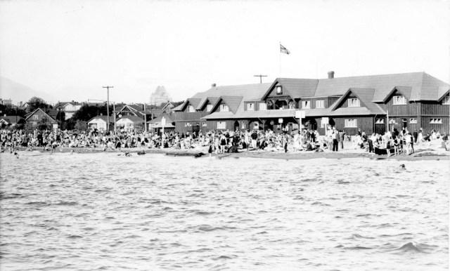 View of Kitsilano Beach, original bathhouse, gazebo and surrounding houses . 1915 Vancouver Park Board