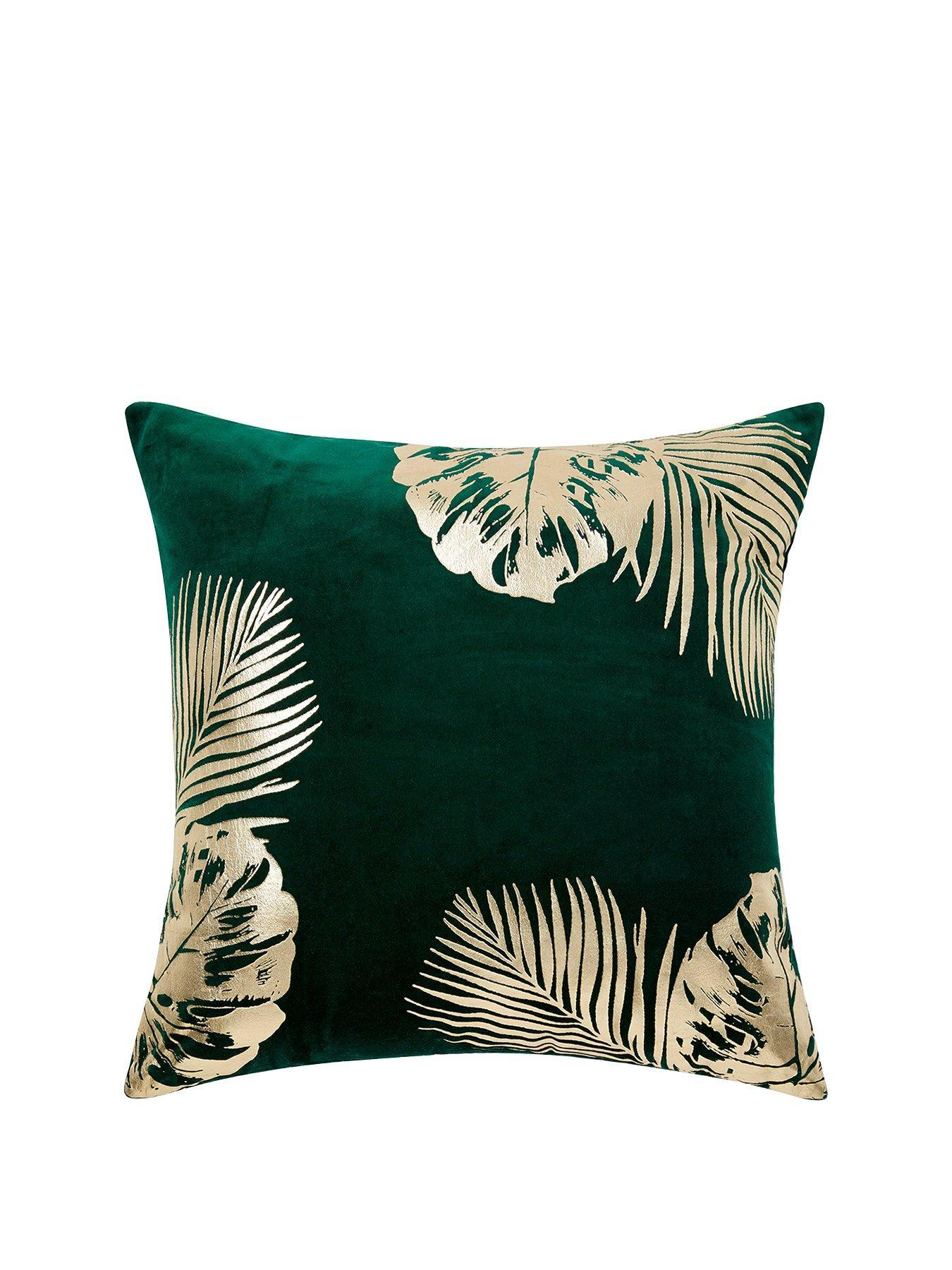 Green and gold leaf print cushion home accessories inspiration| Today we're talking inspiration for adding green to your living room. Green is a really versatile colour to decorate your home with. But, which colours and tones work well? What kind of accessories work with green? This post gives you ideas for pulling together an elegant green colour palette and pieces for your home. Read more: kittyandb.com #greenlivingroom #greenaccessories #greencolorpalette #interiordecoratinginspiration #greenaesthetic #greensofa #cushion #greenandgold