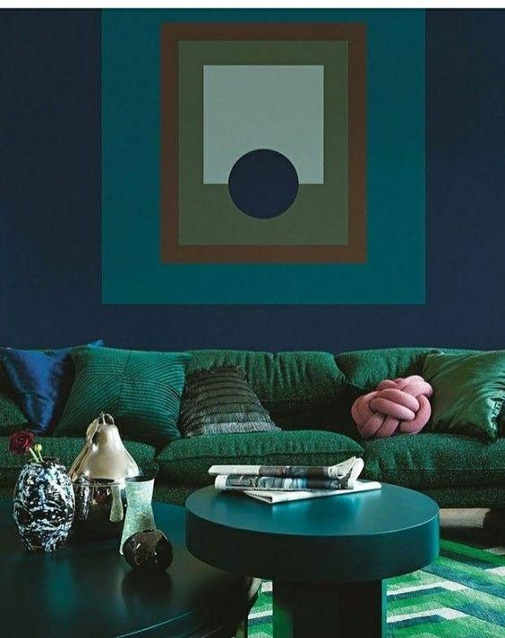Green and blue living room inspiration| Today we're talking inspiration for adding green to your living room. Green is a really versatile colour to decorate your home with. But, which colours and tones work well? What kind of accessories work with green? This post gives you ideas for pulling together an elegant green colour palette and pieces for your home. Read more: kittyandb.com #greenlivingroom #greencolorpalette #interiordecoratinginspiration #greenaesthetic #greensofa #statementwalls #blueandgreen
