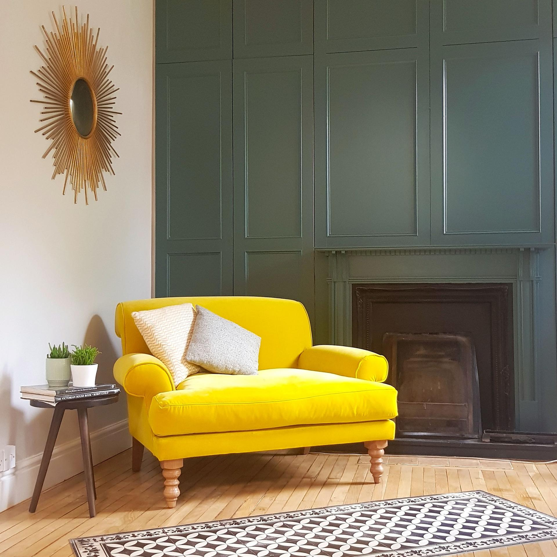 Green Panelled Walls with Yellow Chair | Green Living Room Inspiration| Today we're talking inspiration for a green living room. Green is a really versatile colour to decorate your home with. But, which colours and tones work well? What kind of accessories work with green? This post gives you ideas for pulling together an elegant green colour palette and pieces for your home. Read more: kittyandb.com #greenlivingroom #greencolorpalette #Greenandyellow #greenaesthetic #colourfulhomedecor