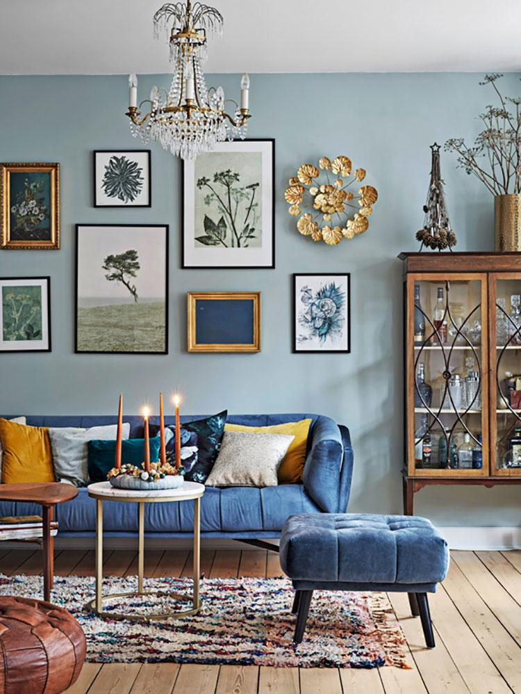 Blue Living Room with Gallery Wall Decor Inspiration| Blue is a really versatile colour to decorate your home with. But, which colours and tones work well? What kind of accessories work with blue? This post gives you ideas for pulling together an elegant blue colour palette and pieces for your home. Read more: kittyandb.com #blueroom #livingroom #GalleryWall #colourfulhomedecor #bluecolorpalette #blueaesthetic