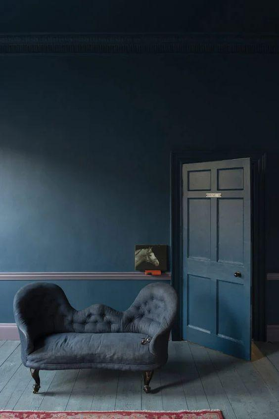 Moody Stiffkey Blue Tonal Living Room| Blue is a really versatile colour to decorate your home with. But, which colours and tones work well? What kind of accessories work with blue? This post gives you the shades you need to recreate this ombre wall, plus ideas for pulling together an elegant blue colour palette and pieces for your home. Read more: kittyandb.com #blueroom #livingroom #colourfulhomedecor #bluecolorpalette #stiffkeyblue #blueaesthetic