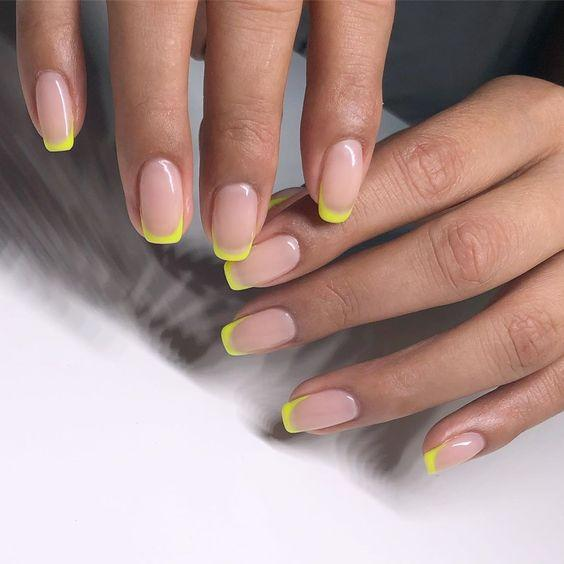 Neon Yellow French Manicure Tips | We love a classic French manicure, it's elegant and timeless. But, we also love classic with a twist. Here are all the alternative French manicure styles you need | www.kittyandb.com #Neon #Nails #NailArt #French #Tip #Yellow