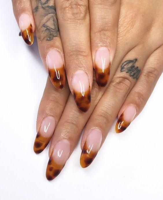 Animal Print French Manicure Tips | We love a classic French manicure, it's elegant and timeless. But, we also love classic with a twist. Here are all the alternative French manicure styles you need | www.kittyandb.com #Animal Print #AnimalPrintNails #NailArt #French #Tip #FrenchManicure #Nails