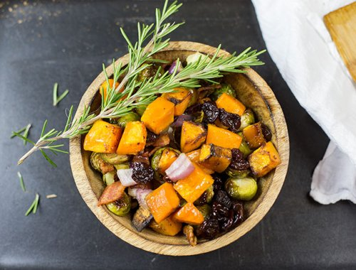 Roasted Brussels Sprouts and Butternut Squash combines two delicious vegetables, bacon, nuts, dried berries and maple syrup to create a colorful side dish.