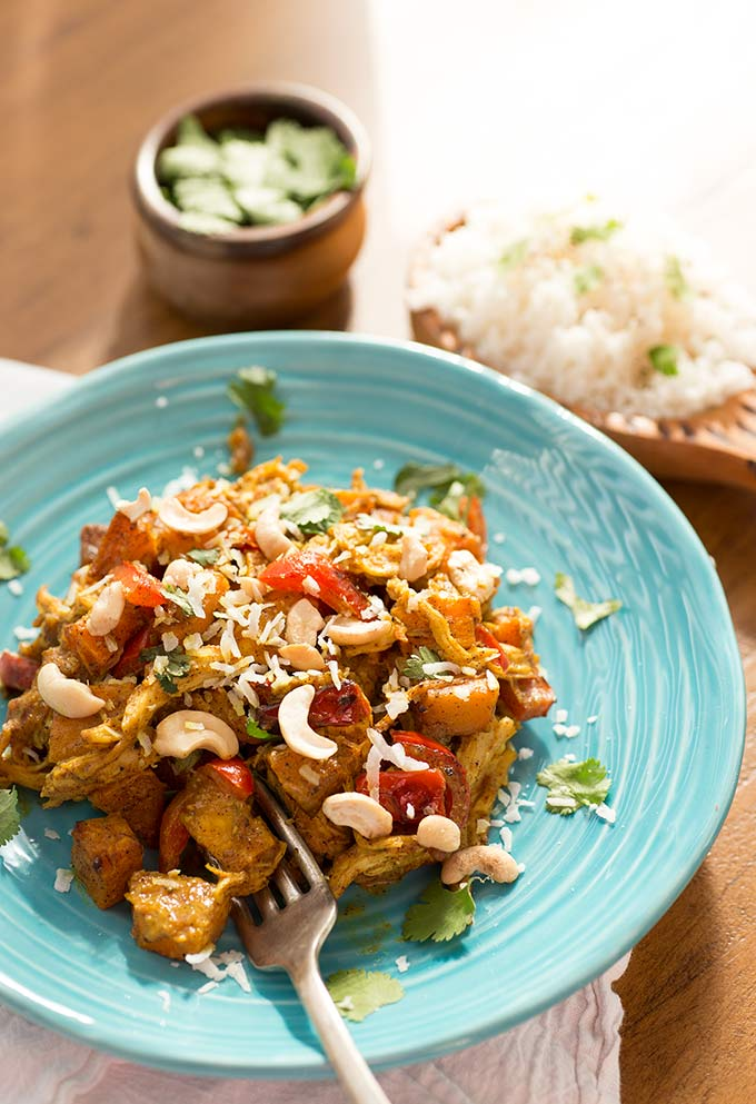 This Paleo Coconut Curry combines roasted vegetables with shredded chicken, spices and thick coconut milk for a filling, healthy and Whole30-approved meal!