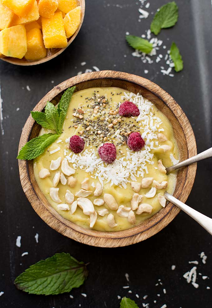 This Mango Mint Smoothie Bowl recipe combines mangoes, bananas and fresh mint for a cool and refreshing treat.