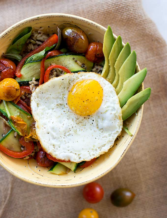 "The ultimate ""bowl,"" this Rice and Veggie Bowl combines fresh veg with grains and the creamy taste of fried egg to create the perfect all-in-one dinner!"