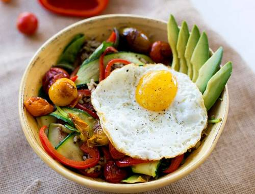 """The ultimate """"bowl,"""" this Rice and Veggie Bowl combines fresh veg with grains and the creamy taste of fried egg to create the perfect all-in-one dinner!"""