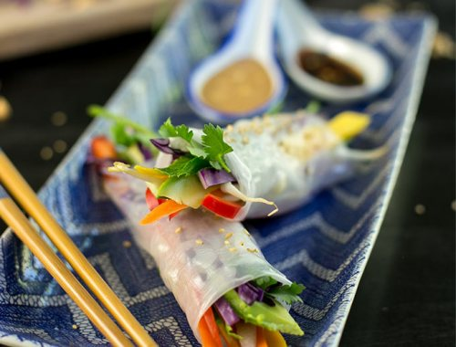 Raw Veggie Spring Rolls...rice paper rolled with colorful fruits and veggies and dipped in creamy peanut and honey-sesame sauces. Raw, fresh and delicious!