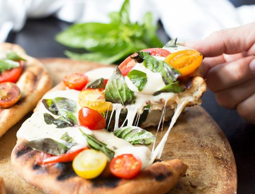 Grilled Margarita Pizza - a fresh and delicious recipe combining mozzarella cheese, fresh basil and garden tomatoes on a garlic and olive oil-brushed crust.