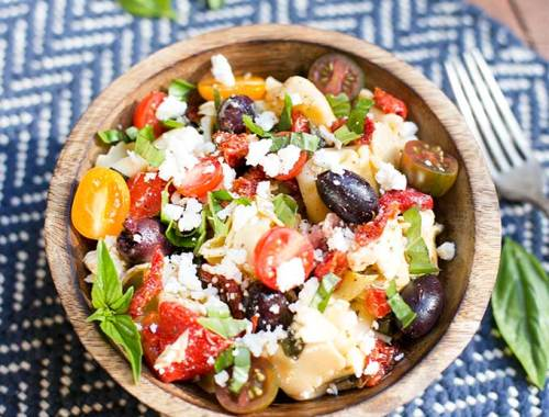 Mediterranean Tortellini Salad - a simple, fresh recipe combining cheese tortellini with tomatoes, artichokes, Kalamata olives and a red-wine vinaigrette.