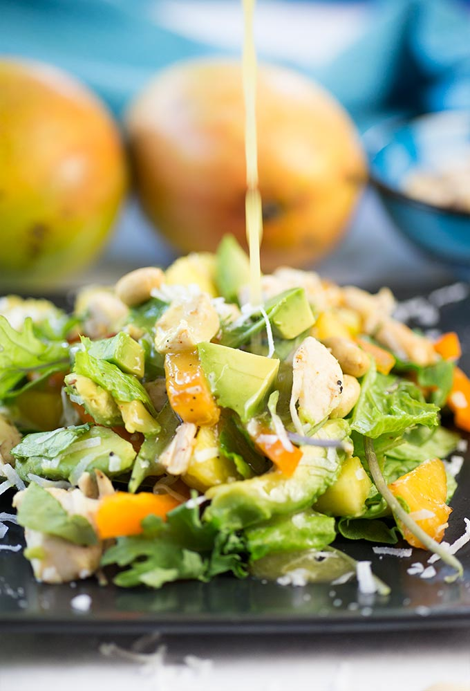 Tropical Chicken Salad - mixed greens, fresh fruit, chicken, avocado, and crunchy peanuts, topped with a coconut vinaigrette for a taste of the Caribbean.