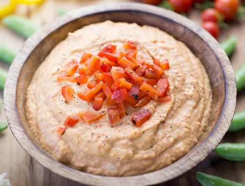 This Roasted Red Pepper Hummus combines sweet bell peppers with chickpeas and spices for a fresh and healthy appetizer or snack. Eat with sliced veggies!