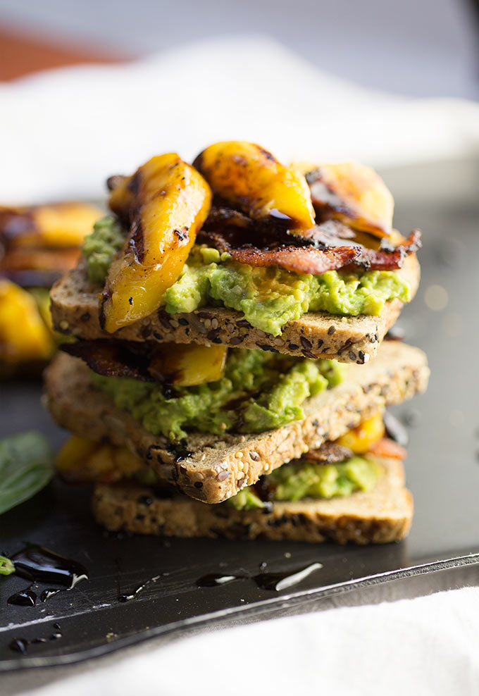 New spin on the BLT....Avocado Toast with Bacon and Grilled Peaches! Drizzled with a sweet balsamic syrup, this is 30-minute dinner perfection!